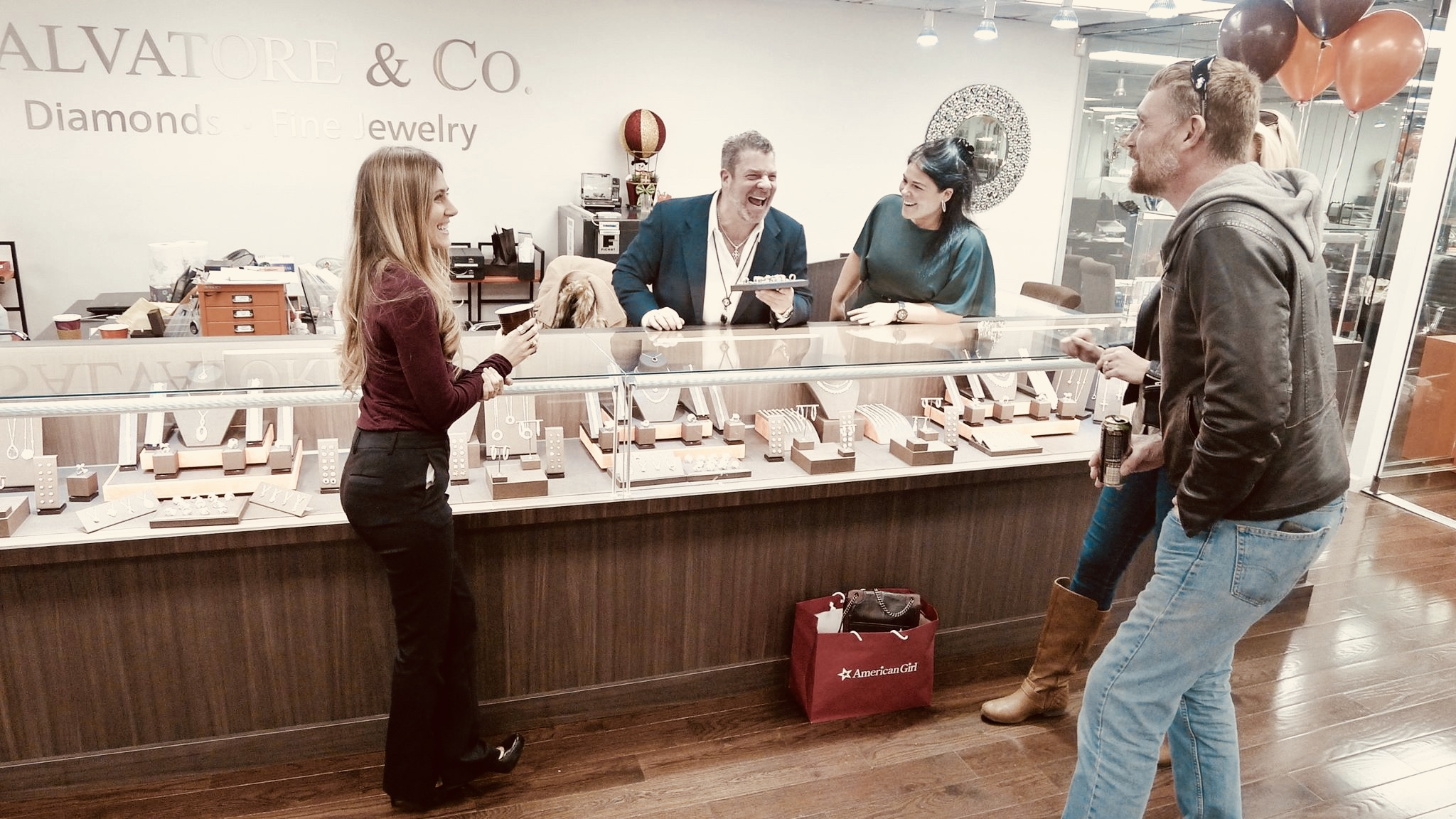 Michael Salvatore and Stephanie Talian laugh with customers