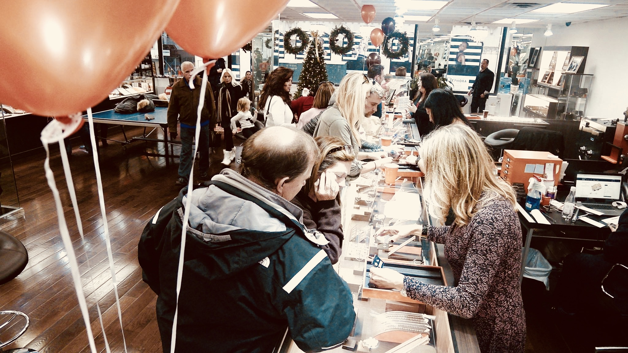 customers flood the store at the 2016 holiday party