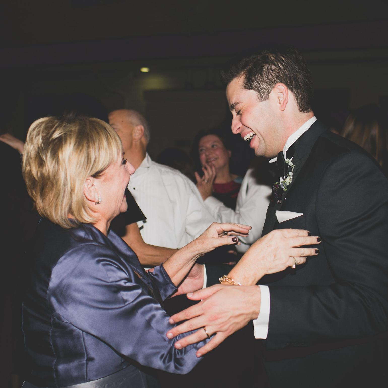 GROOM DANCING LAUGHING