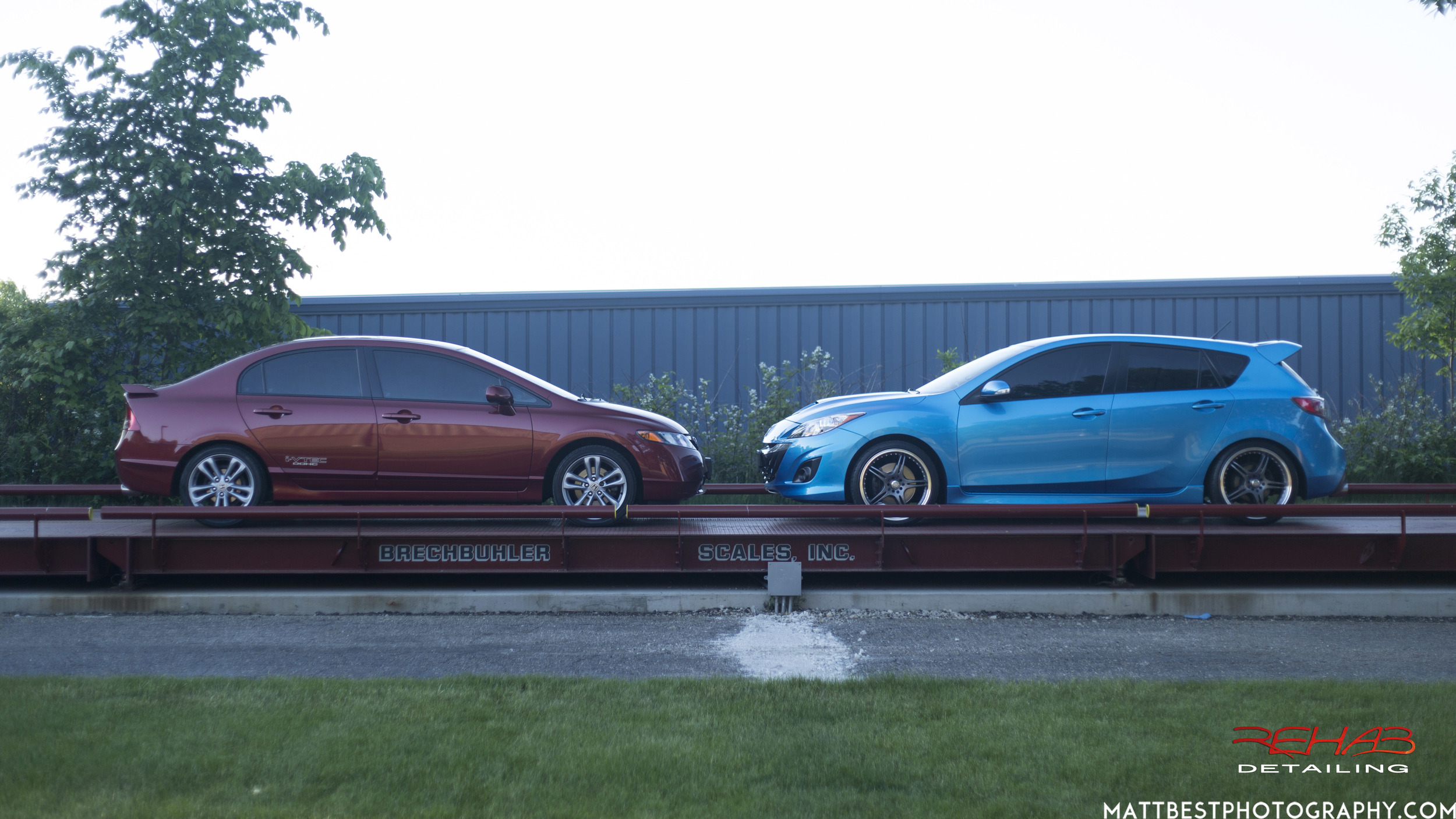 The blue Mazdaspeed 3 is tinted with 20% all the way around, the red Honda Civic Si is tinted with 35% all the way around