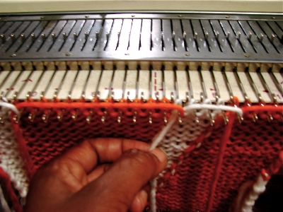 Intarsia,  is the laying-in of individual colors to be knitted. This technique is used to make imagery in the fabric.