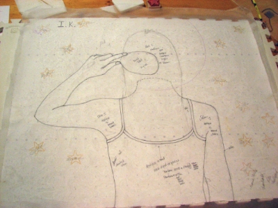 The paper stitch plan, traced onto the silk organza ground fabric.