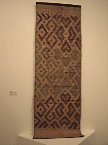 This woven mat was a first for  me,  but common for a people who decorated their entire existence. Kuba people, Bushoong group. 19th-20th century; raffia; 43-1/4 x 118-7/8 in (110 x 302 cm).