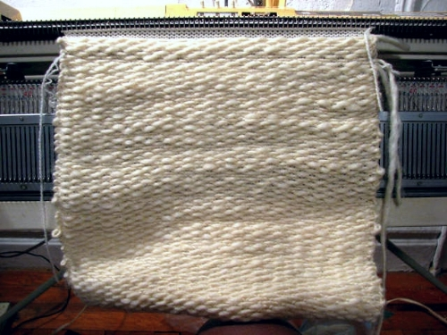 The yarn was machine knit into 42 separate panels.