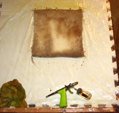 Airbrushing dye to panel.