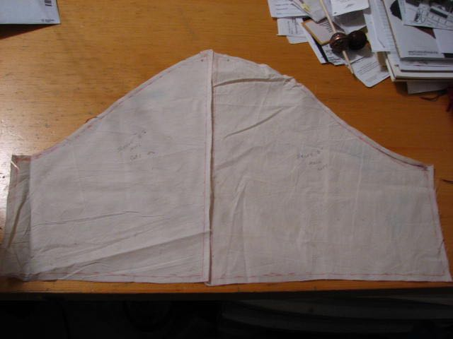Muslin was draped around the parts of the sculpture to covered, marked and transformed into a pattern template .