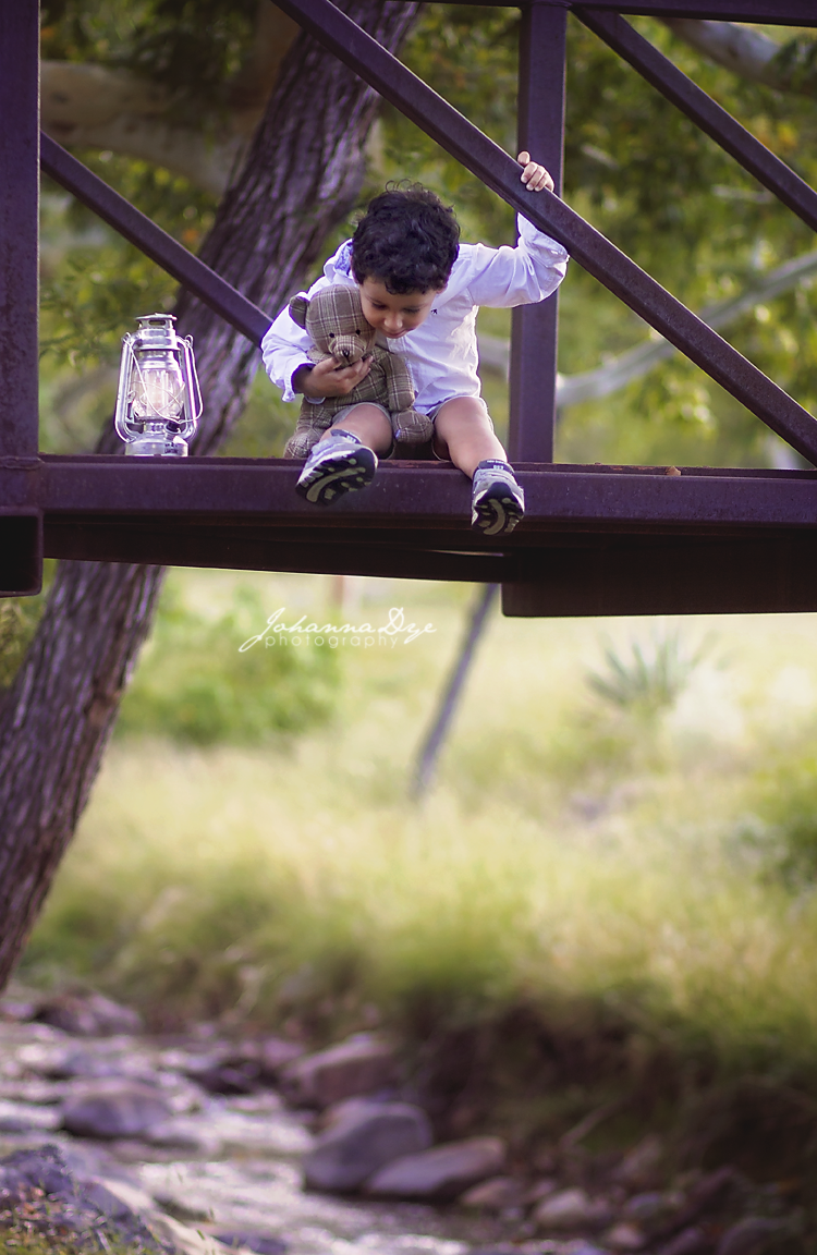 Look how far down it goes, Pooh Bear! If you hold on to your Teddy Bear, the world is better. Children Photography with a Teddy Bear and a Light! in North Carolina