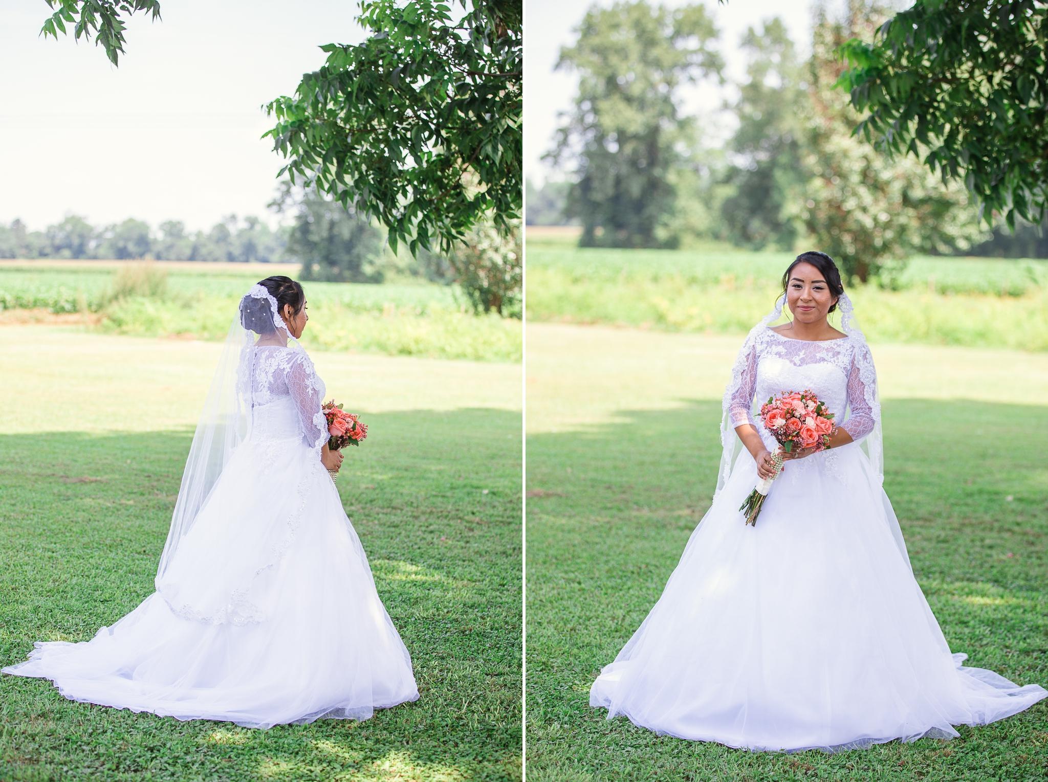 Bride in Davids Bridal Lace Wedding Dress with Roses St Pauls North Carolina Wedding Photography