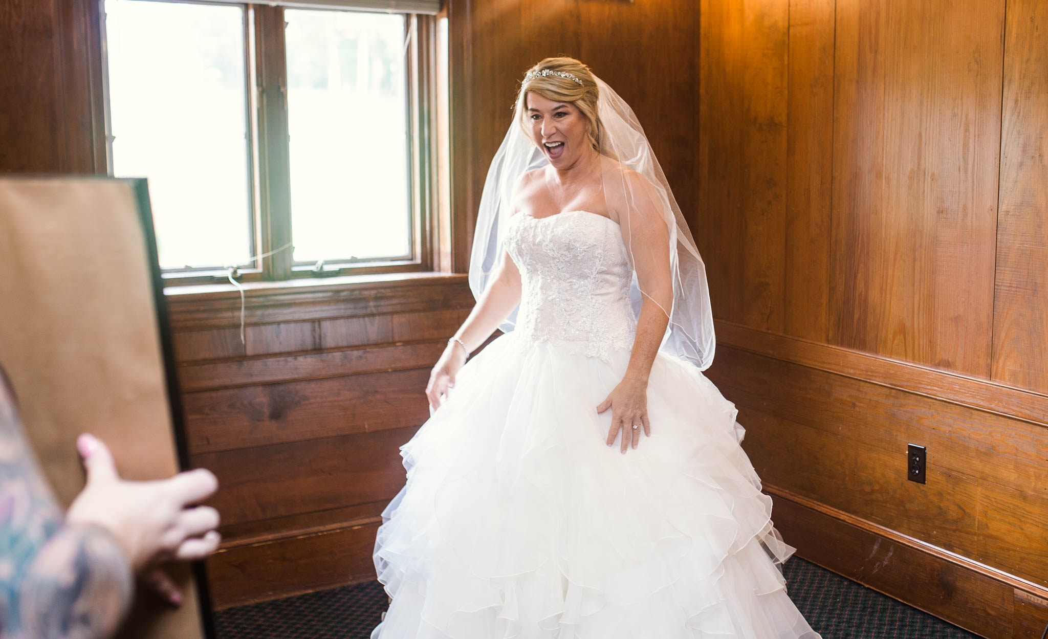 Bride seeing herself in the ball gown wedding dress for the first time - Dona + Doug - MacGregor Downs Country Club in Cary, NC - Raleigh Wedding Photographer