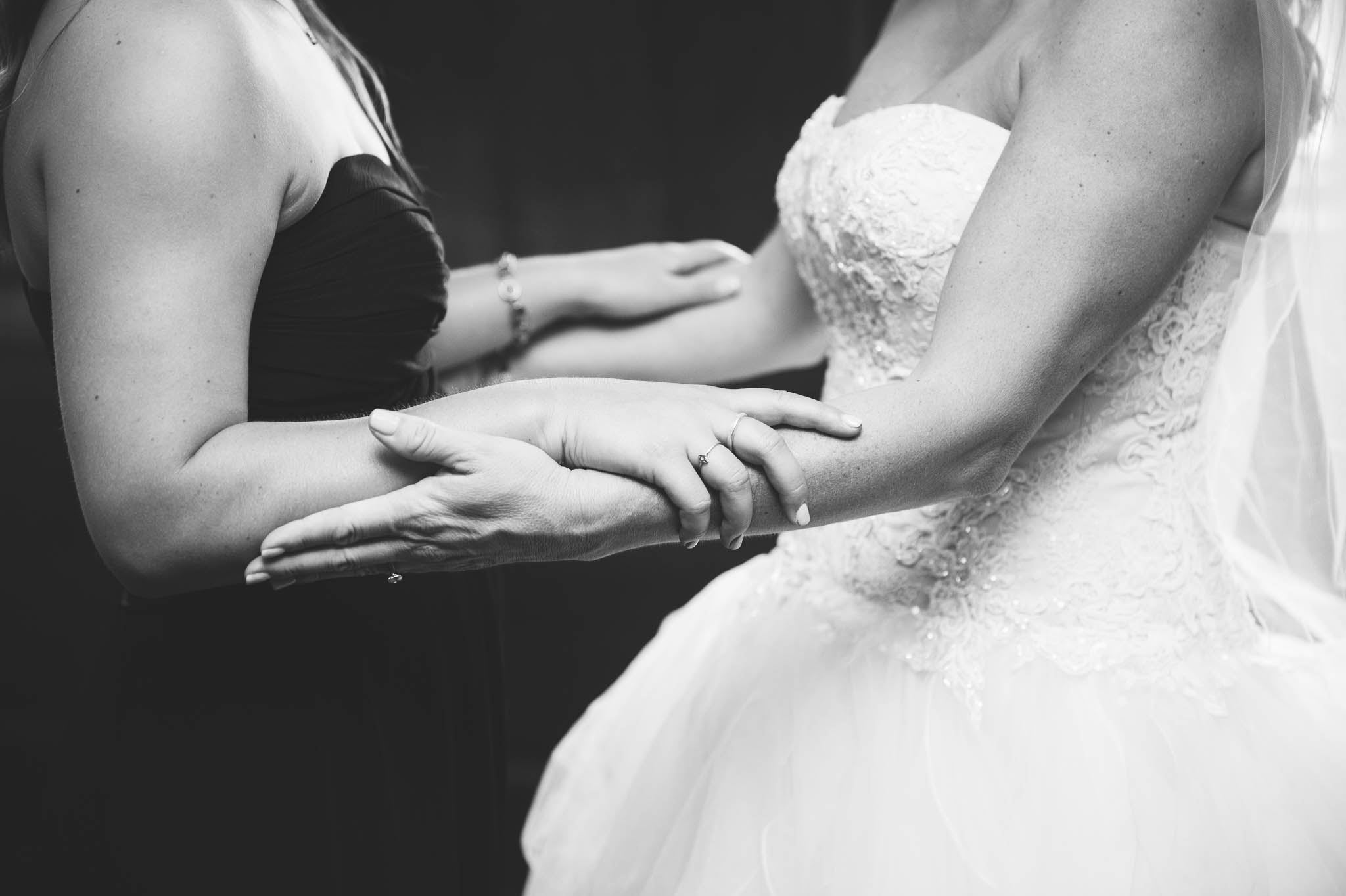 Bride and her daughter holding hands before the wedding - Dona + Doug - MacGregor Downs Country Club in Cary, NC - Raleigh Wedding Photographer