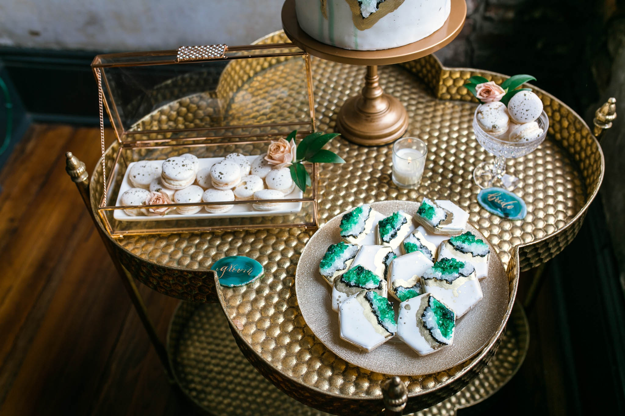 Close up of the Wedding Desert Table with a Geode Wedding Cake, Macaroons and Geode Cookies in Emerald, Marble and Gold Colors - Oahu Hawaii Wedding Photographer