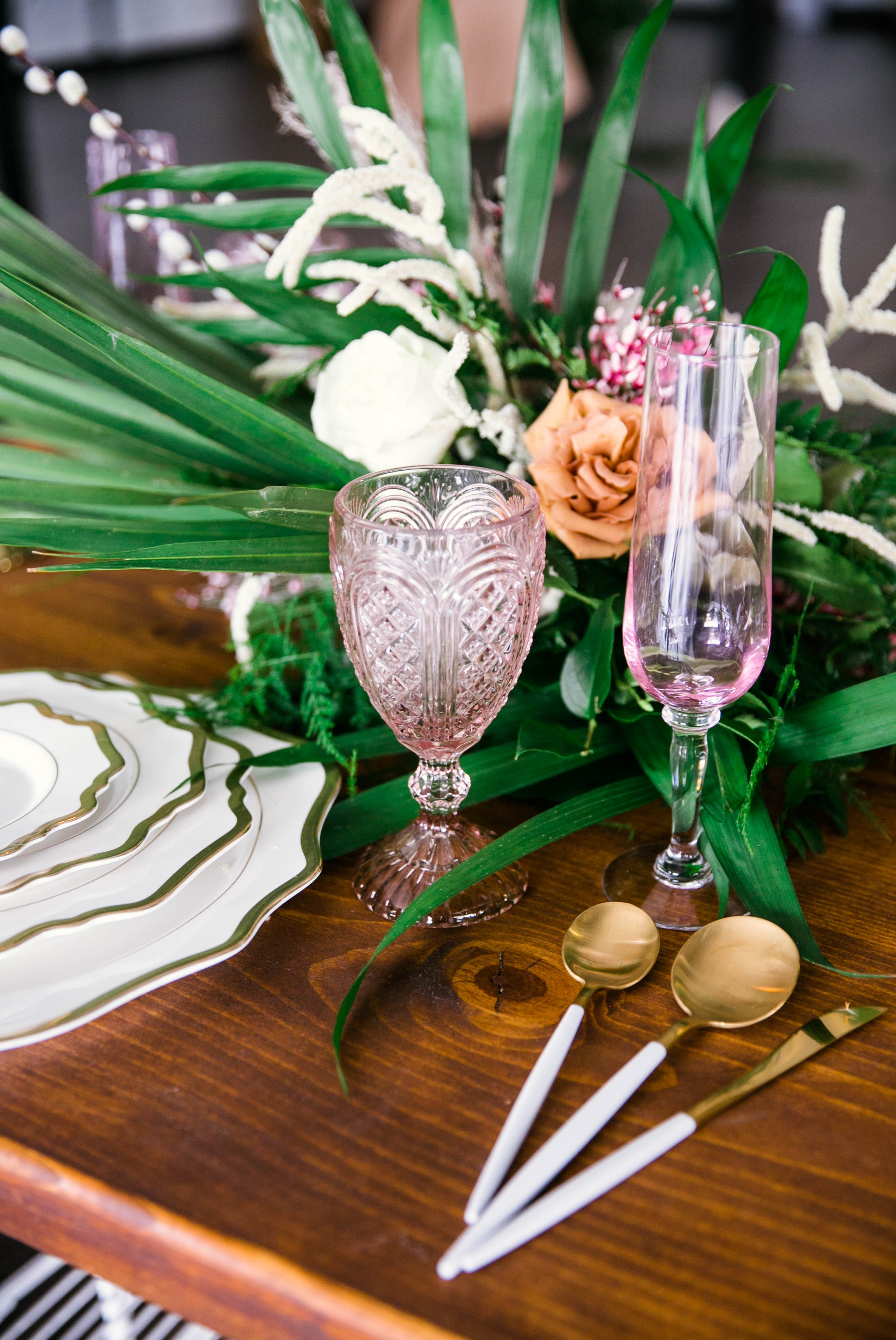 Wedding Table Setting with white and gold plates, pink glass wear, gold and white silverware - Tropical Destination Wedding Inspiration - Honolulu, Oahu, Hawaii Photographer
