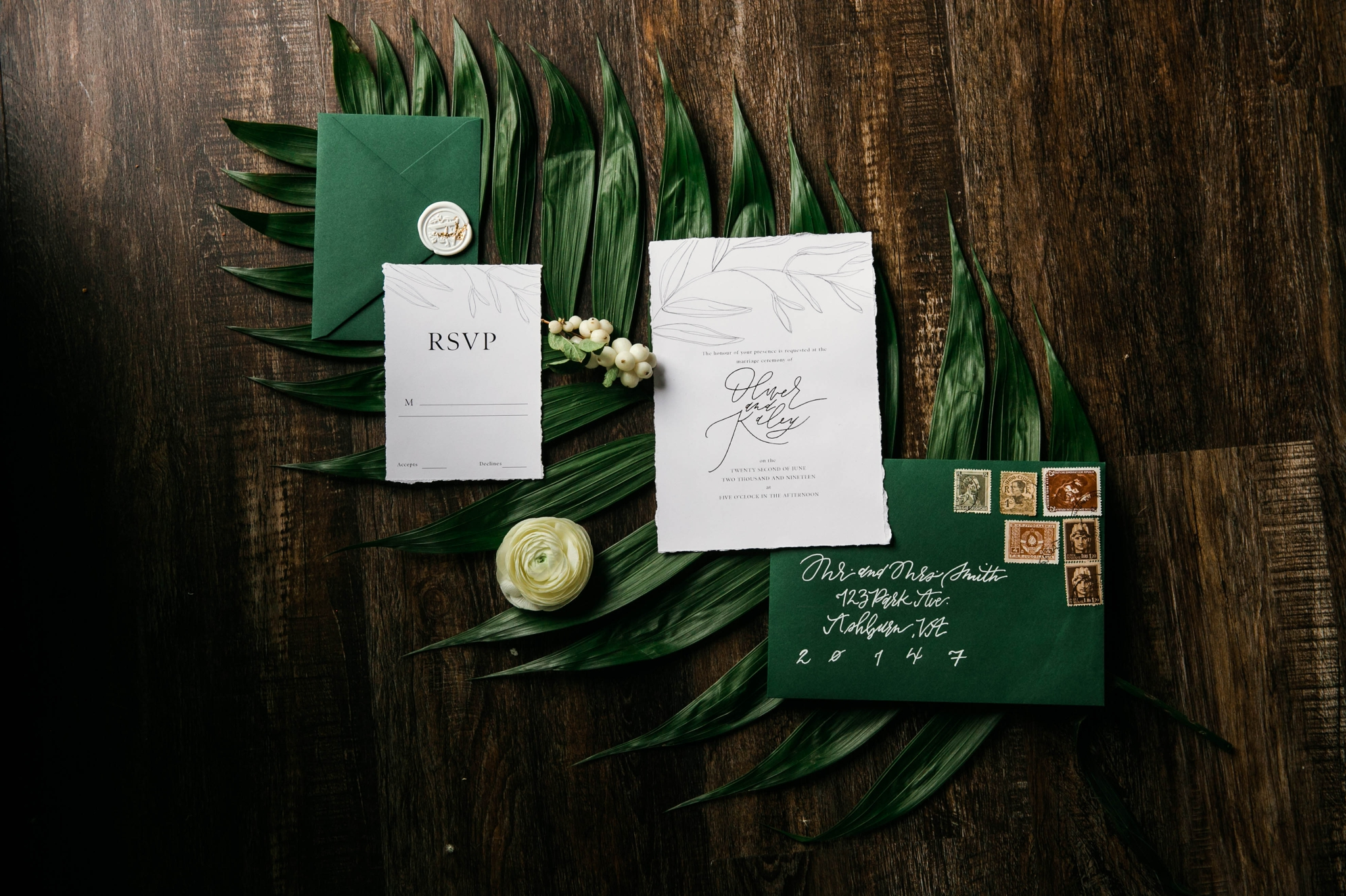 Lay flat of Wedding Invitation Suite with a tropical leave as the background styled by Johanna Dye Photography designed by Tortoise.Design - Oahu Hawaii Wedding Photographer