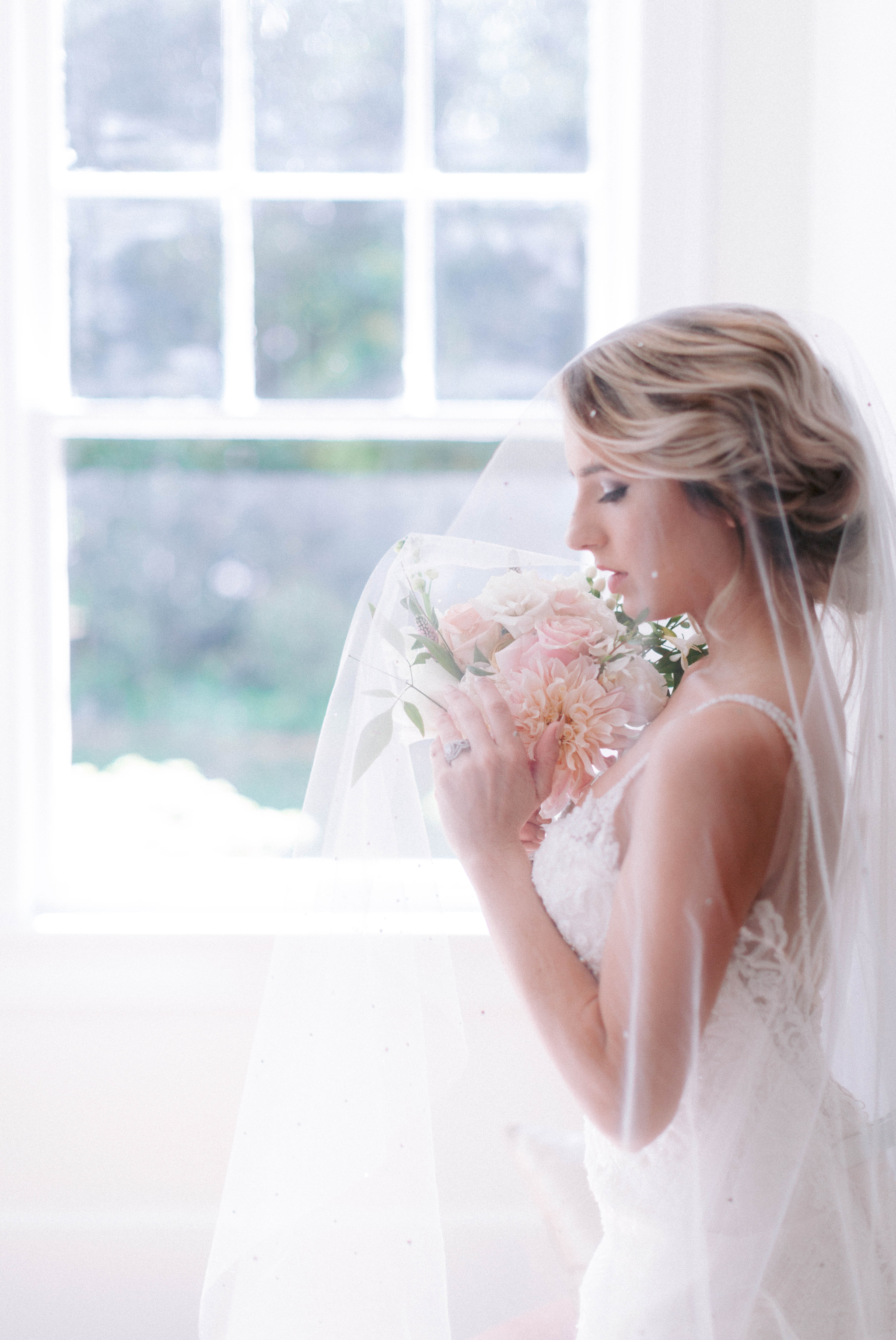 Indoor Natural Light Bridal Portraits by a window with a white backdrop - classic bride with pastel colors - wedding gown by Stella York - Honolulu, Oahu, Hawaii Wedding Photographer