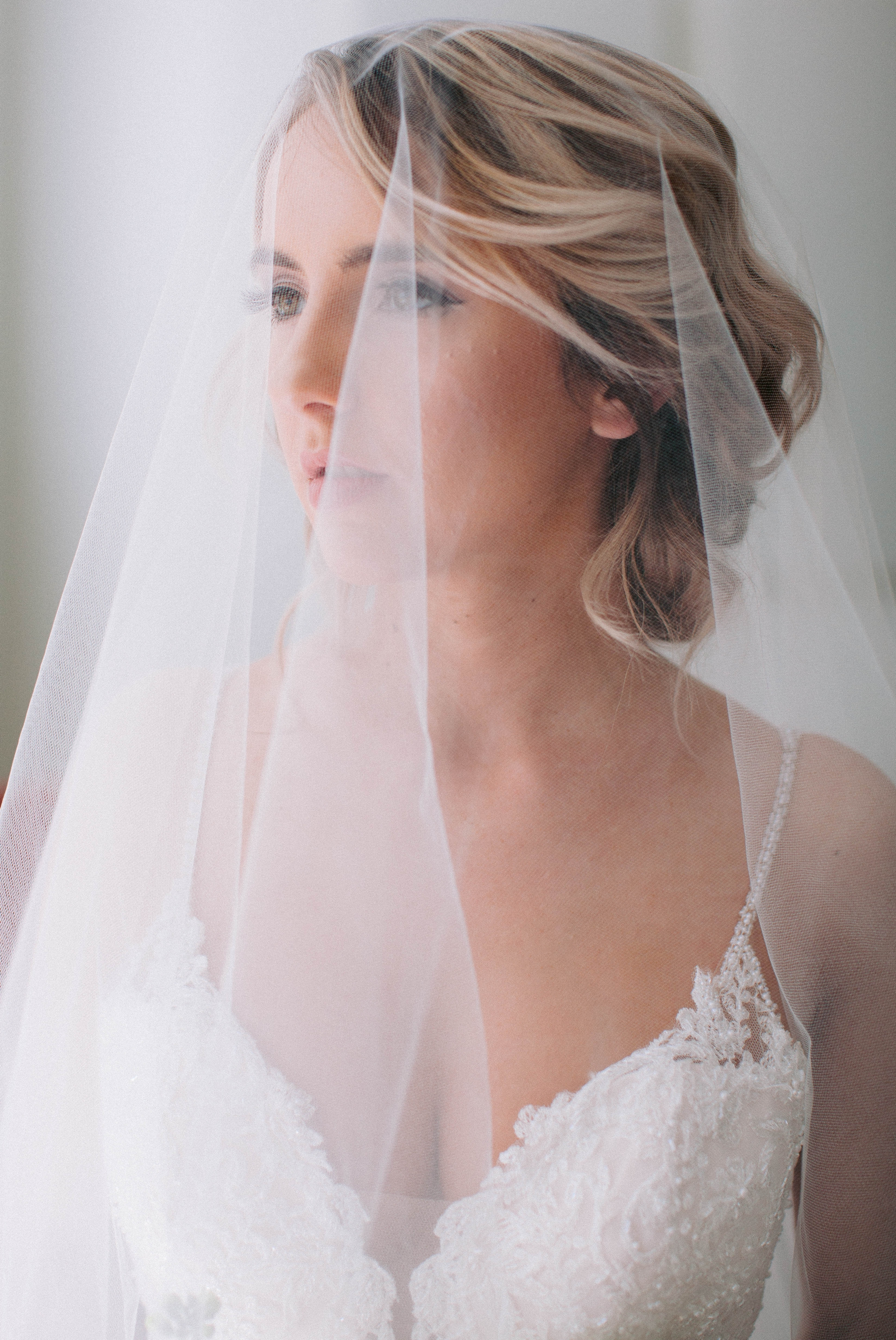 Indoor Natural Light Bridal Portraits by a window with a white backdrop - classic bride with soft drop veil over her face - wedding gown by Stella York - Honolulu, Oahu, Hawaii Wedding Photographer