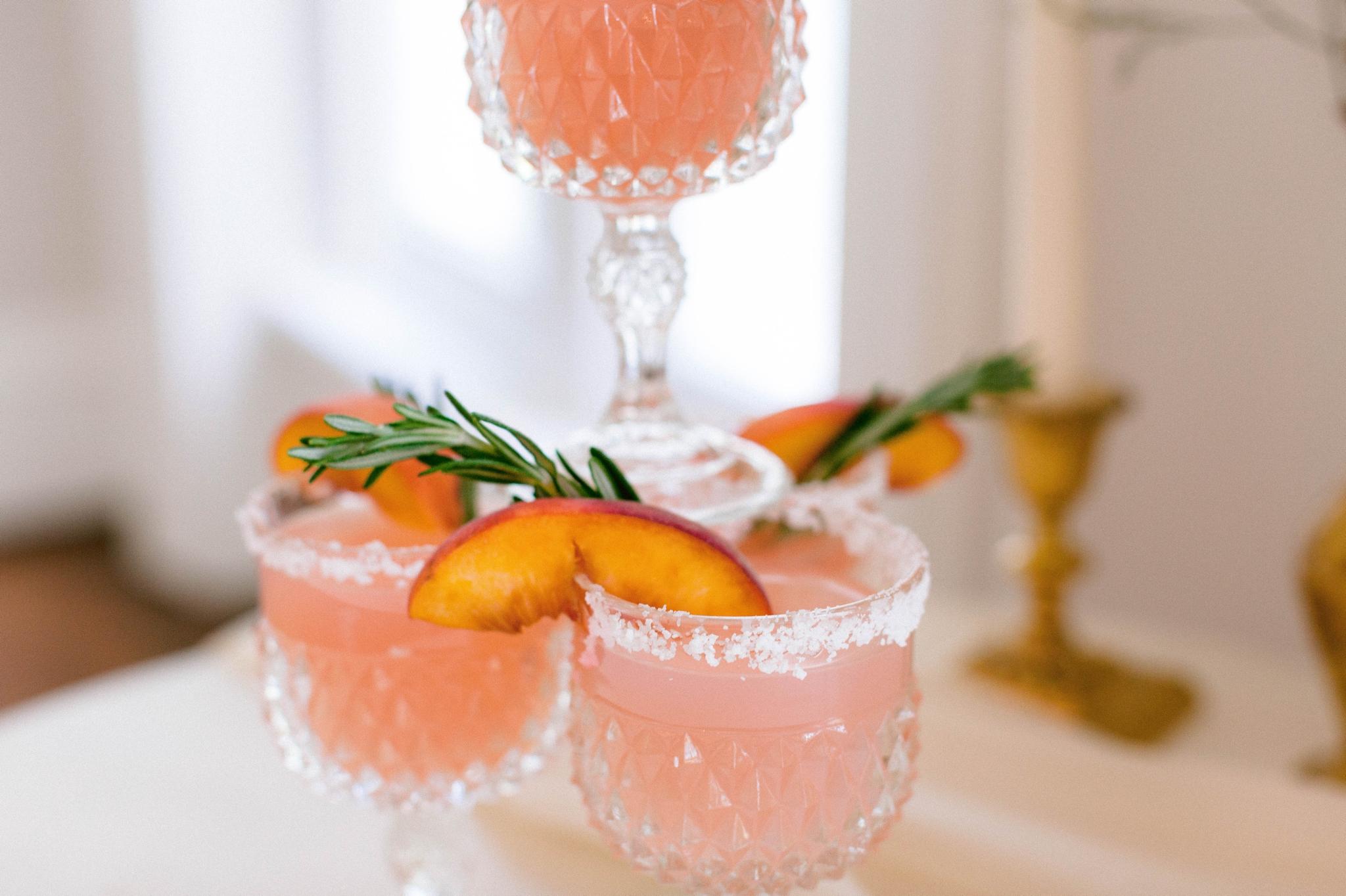pink and salmon colored custom wedding day cocktails with peaches - luxury estate wedding - honolulu oahu hawaii wedding photographer - johanna dye photography