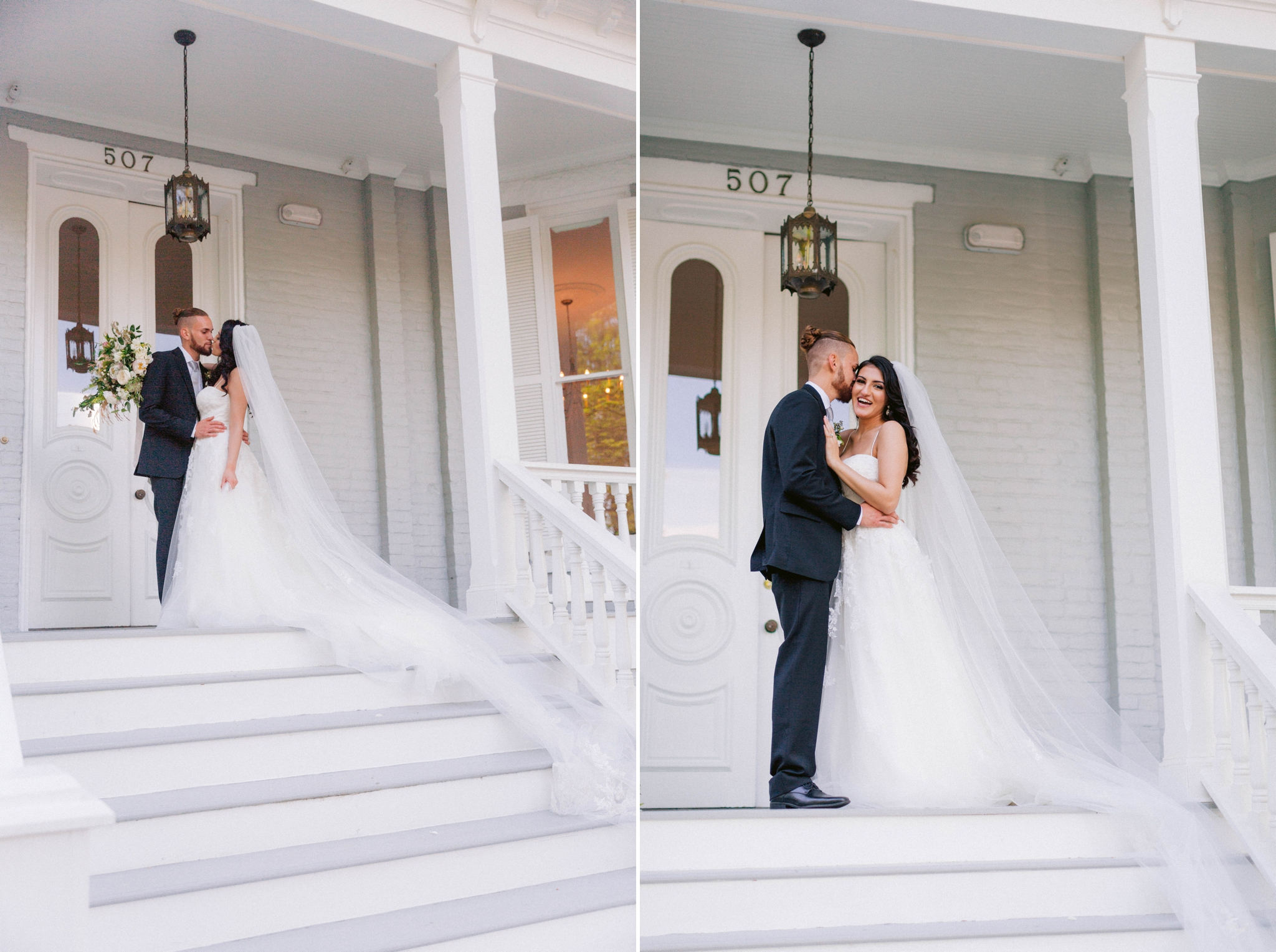 Couple Kissing - Wedding Portraits on the front porch of an  all white luxury estate mansion - Bride is wearing a Aline Ballgown by Cherish by Southern Bride with a long cathedral veil - Groom is wearing a black suit by Generation Tux and has a man bun - Honolulu Oahu Hawaii Wedding Photographer - Johanna Dye Photography