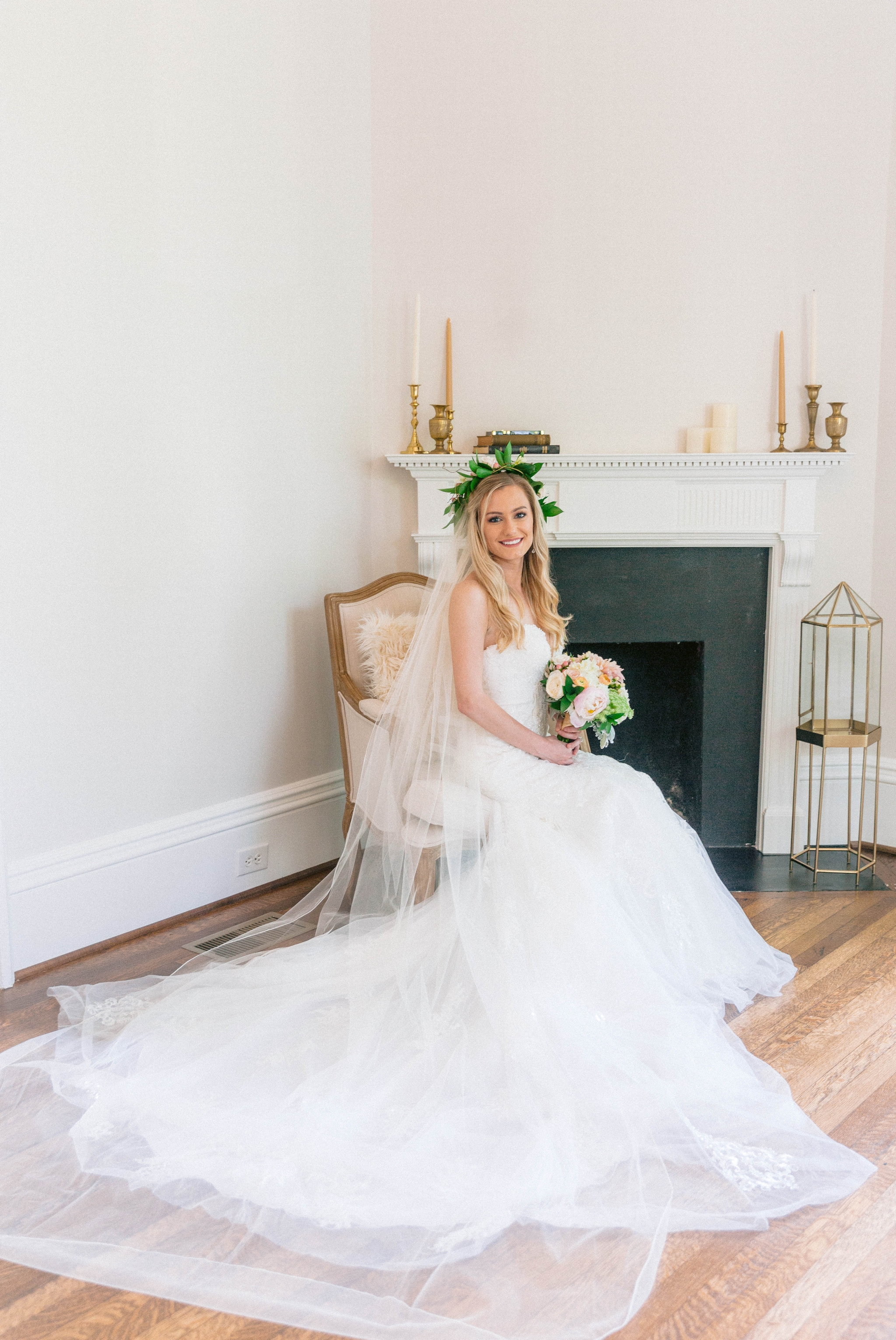 Veil shot - Indoor Bridal Portraits in an all white room at a luxury estate with natural light before the ceremony - Bride is wearing a Hawaiian Flower Crown and a cathedral veil in a Wedding Gown by Stella York sitting on an antique vintage chair in front of a decorated fireplace  - Honolulu Oahu Hawaii Wedding Photographer - Johanna Dye Photography