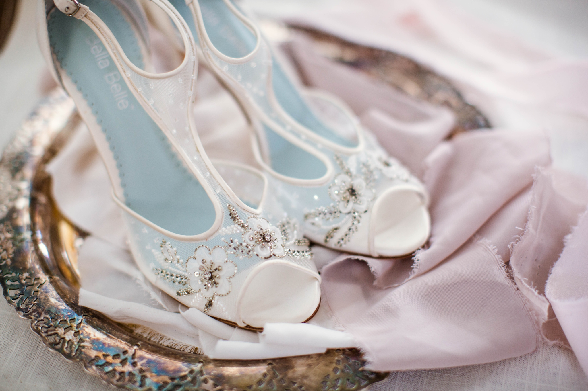 detail shot of all white bridal shoes with light blue details on an antique tray - Fine Art Wedding Photographer in Honolulu, Oahu, Hawaii - edited with the for the love of film presets by jose villa