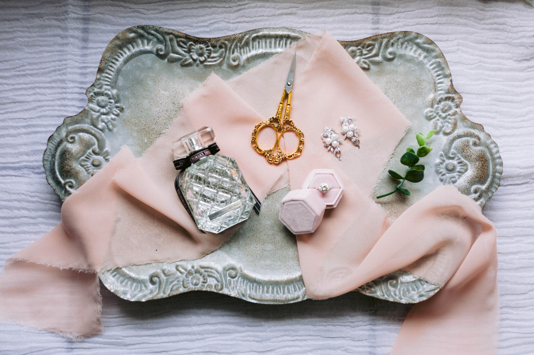 wedding details lay flat with a velvet ring box with engagement ring, golden scissors and a victorias secret perfume - Honolulu Oahu Hawaii Wedding Photographer
