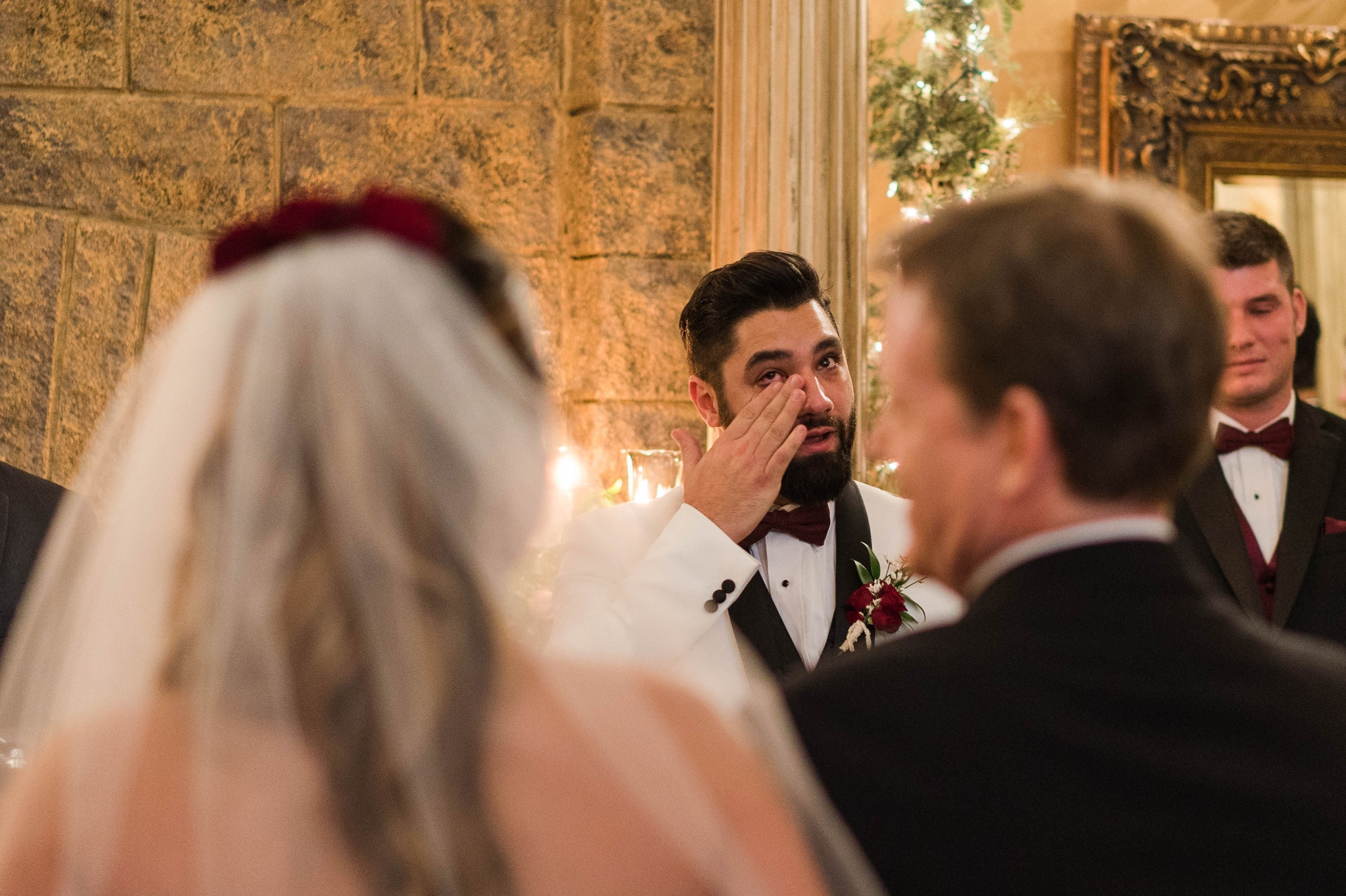 Groom wiping the tears from his face as he sees his bride standing in front of him at the altar - Honolulu Oahu Hawaii Wedding Photographer