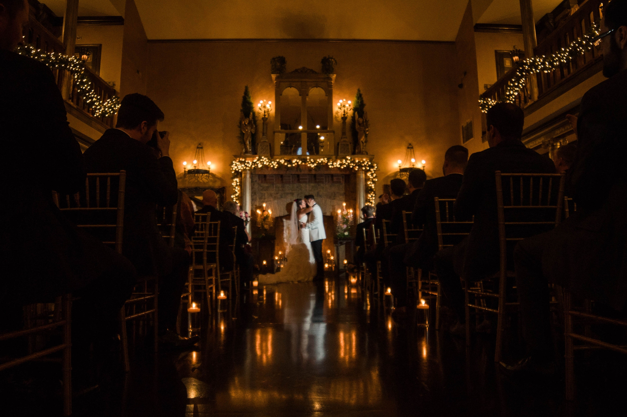 First kiss in a castle lit by candles during the wedding ceremony - Honolulu Oahu Hawaii Wedding Photographer
