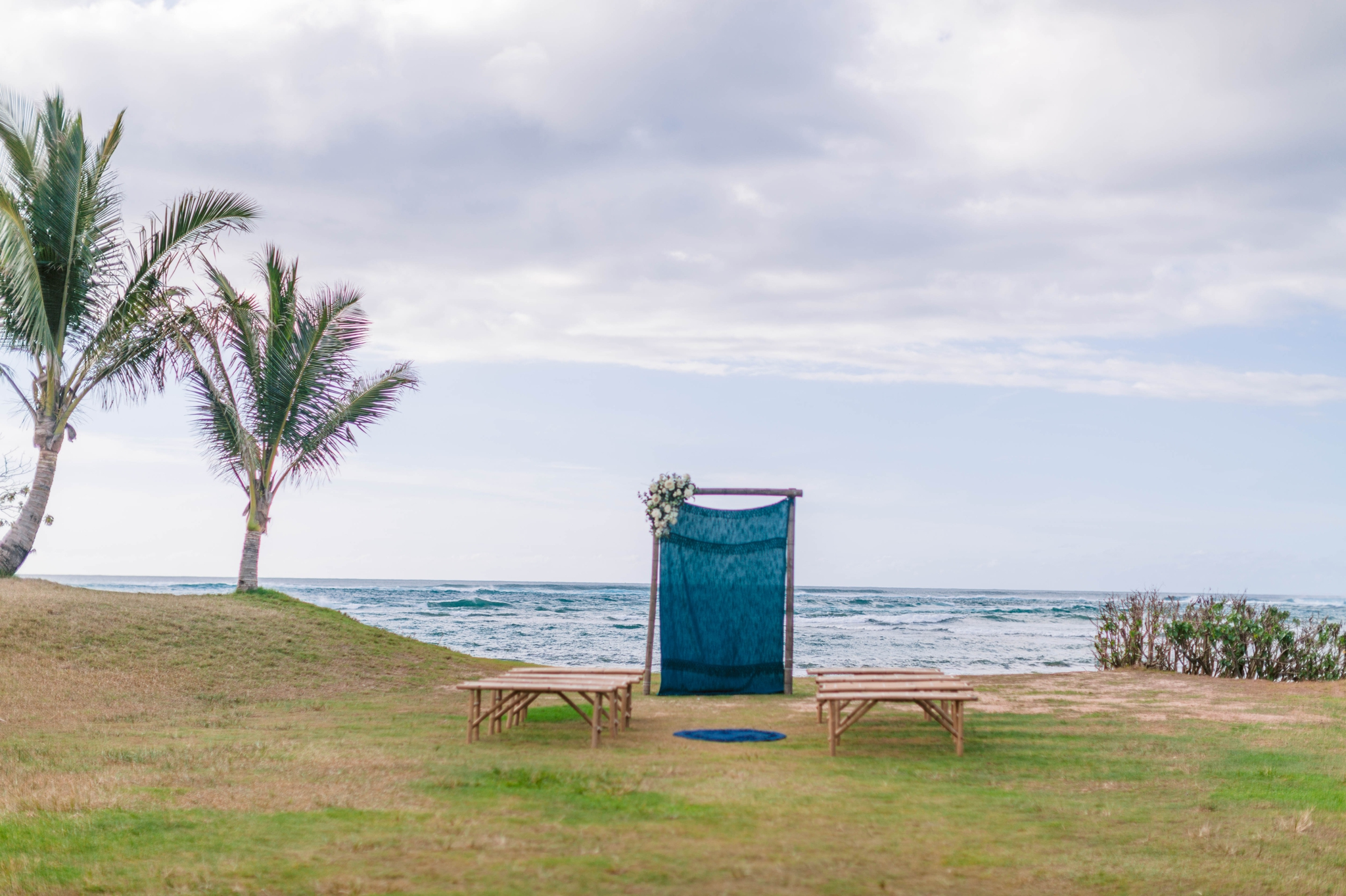 Ceremony Arch with Fabric in front of the ocean - Ana + Elijah - Wedding at Loulu Palm in Haleiwa, HI - Oahu Hawaii Wedding Photographer