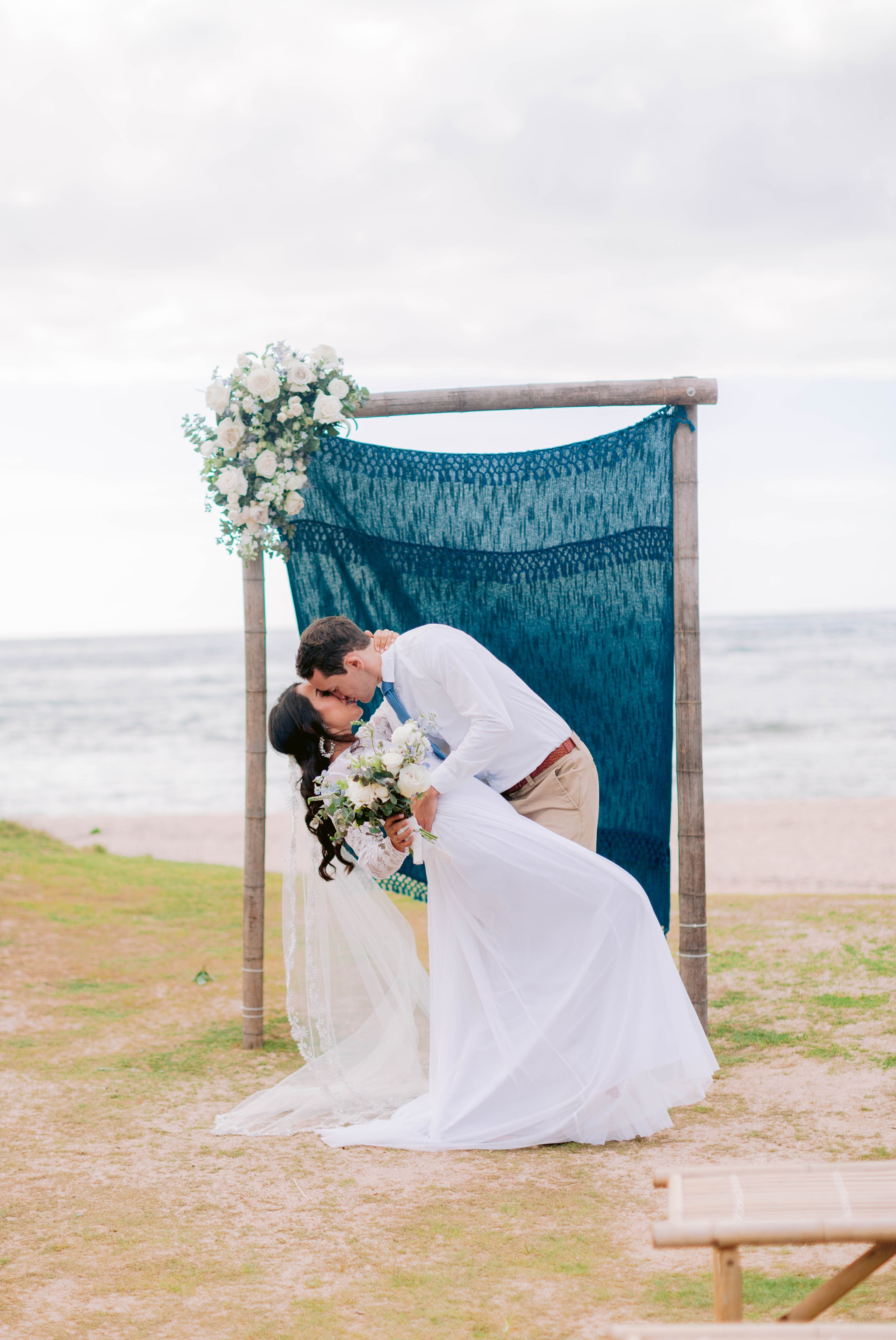 The first kiss between bride and broom at the ceremony Ana + Elijah - Wedding at Loulu Palm in Haleiwa, HI - Oahu Hawaii Wedding Photographer