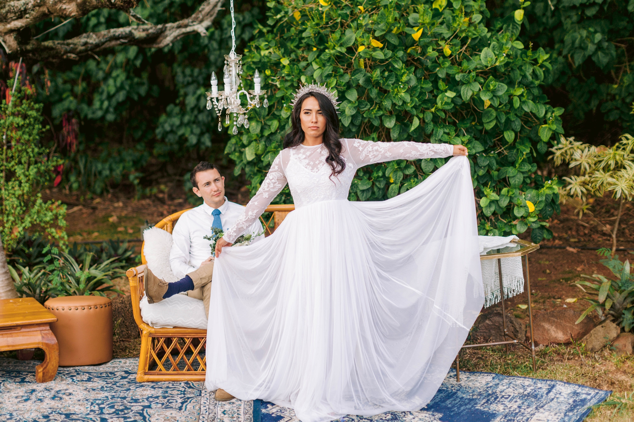 Bride and groom relaxing in an outdoor lounge - bride is wearing a wedding dress by asos and a crystal crown - Ana + Elijah - Wedding at Loulu Palm in Haleiwa, HI - Oahu Hawaii Wedding Photographer