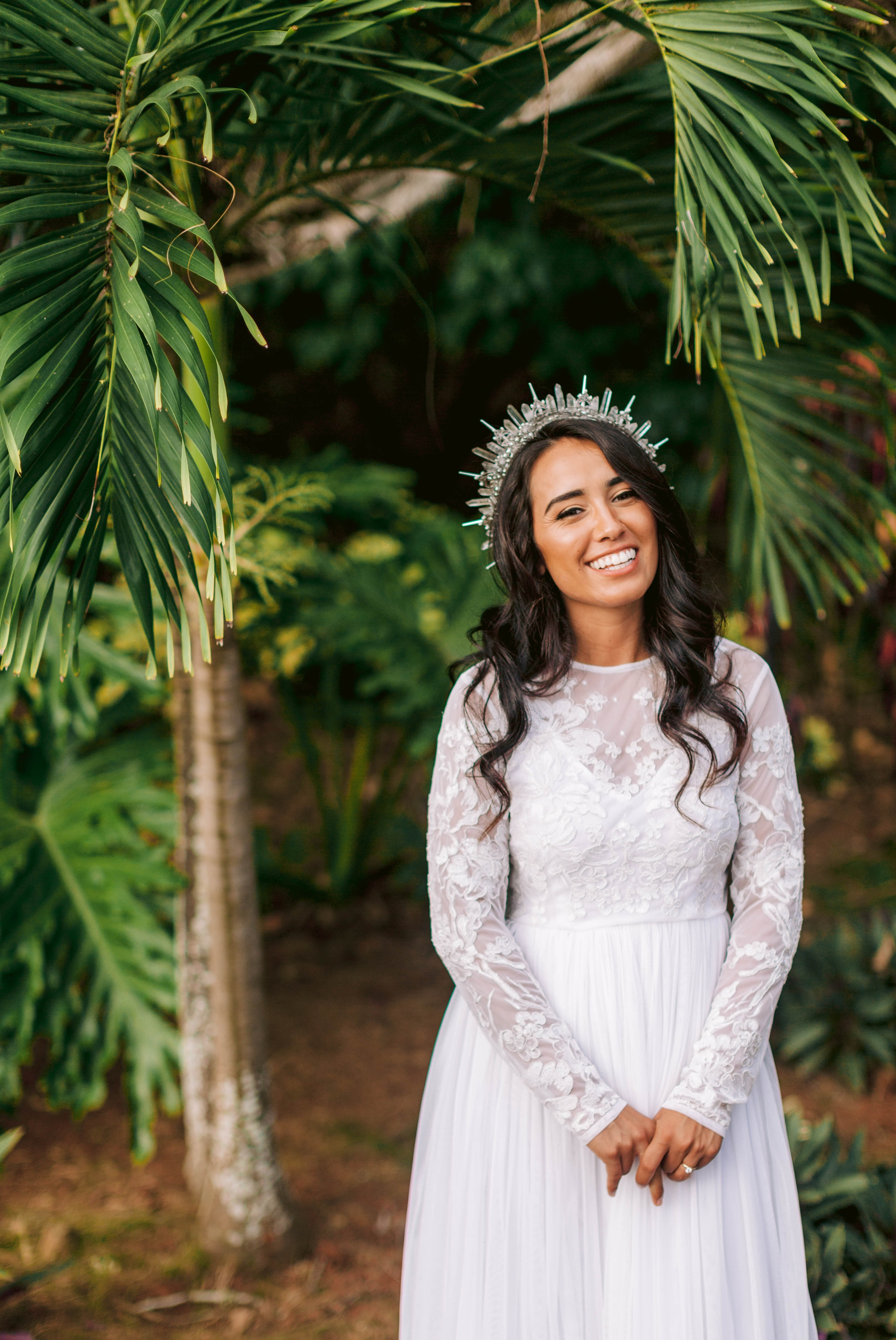 Tropical Bridal Portraits - Bride is wearing a wedding dress by asos and a unique crown under palm trees - Ana + Elijah - Wedding at Loulu Palm in Haleiwa, HI - Oahu Hawaii Wedding Photographer