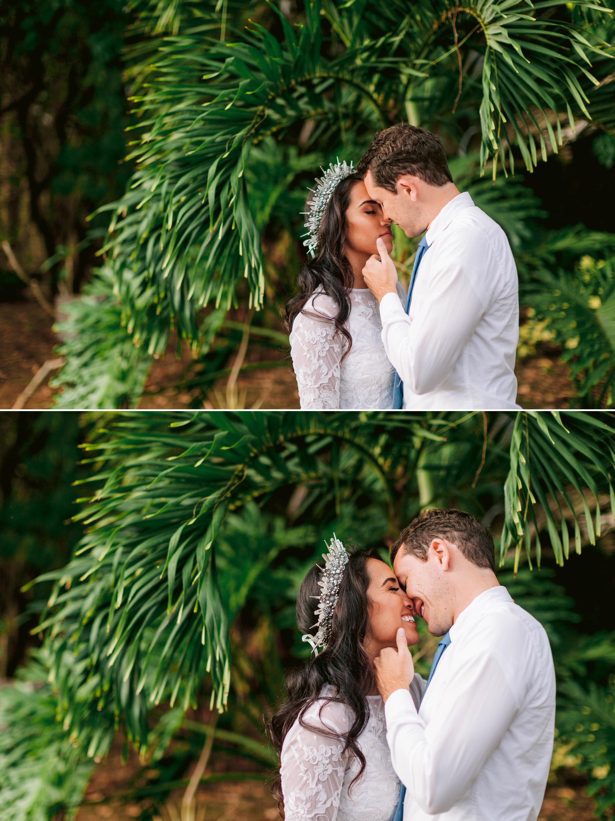Bride and Groom kissing under palm trees -wedding dress by asos and a unique crown Ana + Elijah - Wedding at Loulu Palm in Haleiwa, HI - Oahu Hawaii Wedding Photographer - #hawaiiweddingphotographer #oahuweddings #hawaiiweddings