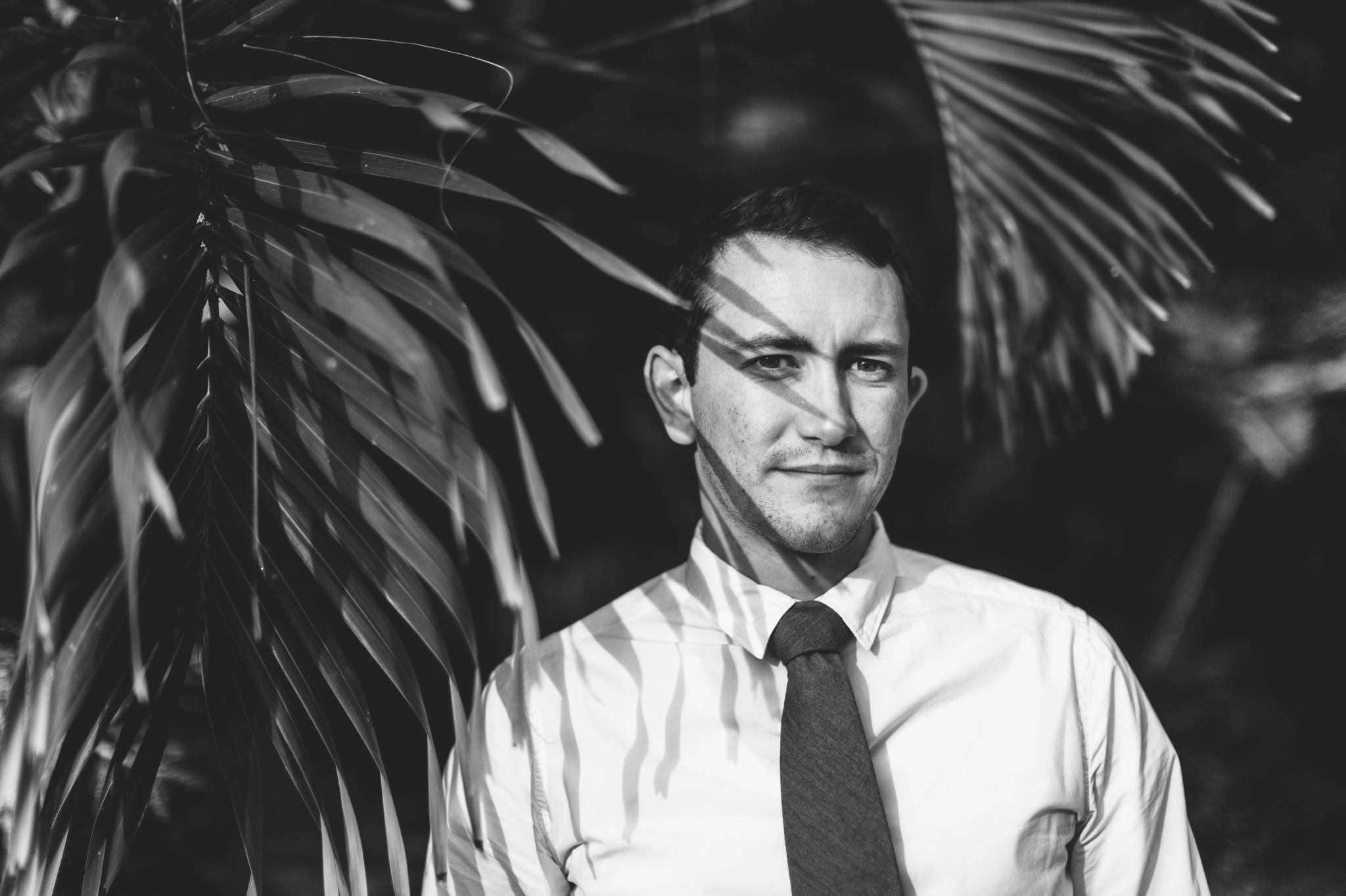 Portrait of the Groom in front of Palm Trees Ana + Elijah - Wedding at Loulu Palm in Haleiwa, HI - Oahu Hawaii Wedding Photographer - #hawaiiweddingphotographer #oahuweddings #hawaiiweddings
