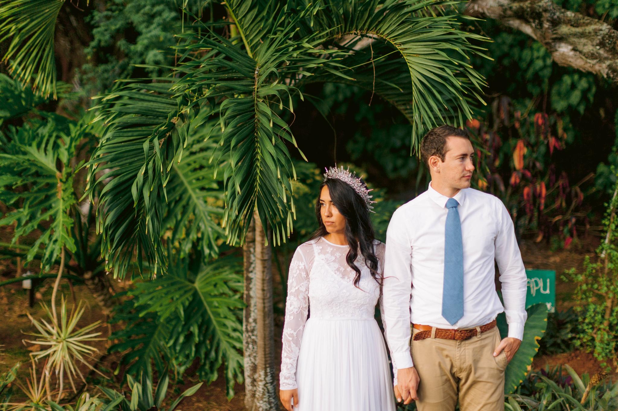 Bride and groom underneath palm trees Ana + Elijah - Wedding at Loulu Palm in Haleiwa, HI - Oahu Hawaii Wedding Photographer - #hawaiiweddingphotographer #oahuweddings #hawaiiweddings