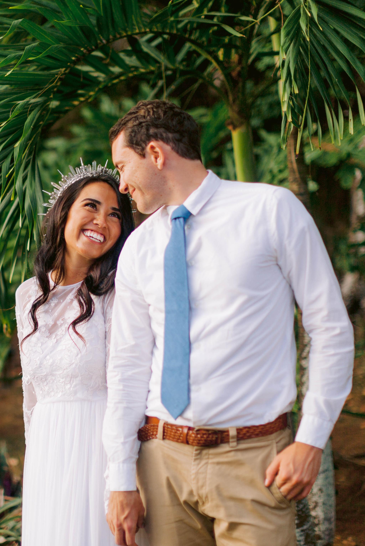 Bride and groom under palm trees - Ana + Elijah - Wedding at Loulu Palm in Haleiwa, HI - Oahu Hawaii Wedding Photographer - #hawaiiweddingphotographer #oahuweddings #hawaiiweddings