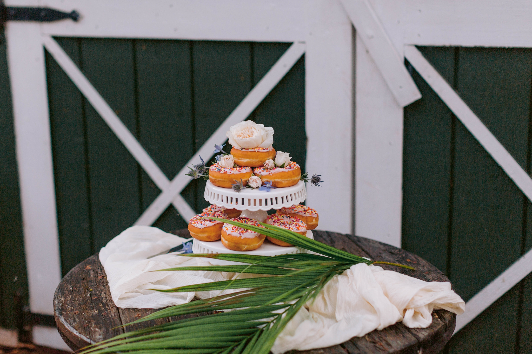 Donuts as the wedding cake - Ana + Elijah - Wedding at Loulu Palm in Haleiwa, HI - Oahu Hawaii Wedding Photographer - #hawaiiweddingphotographer #oahuweddings #hawaiiweddings