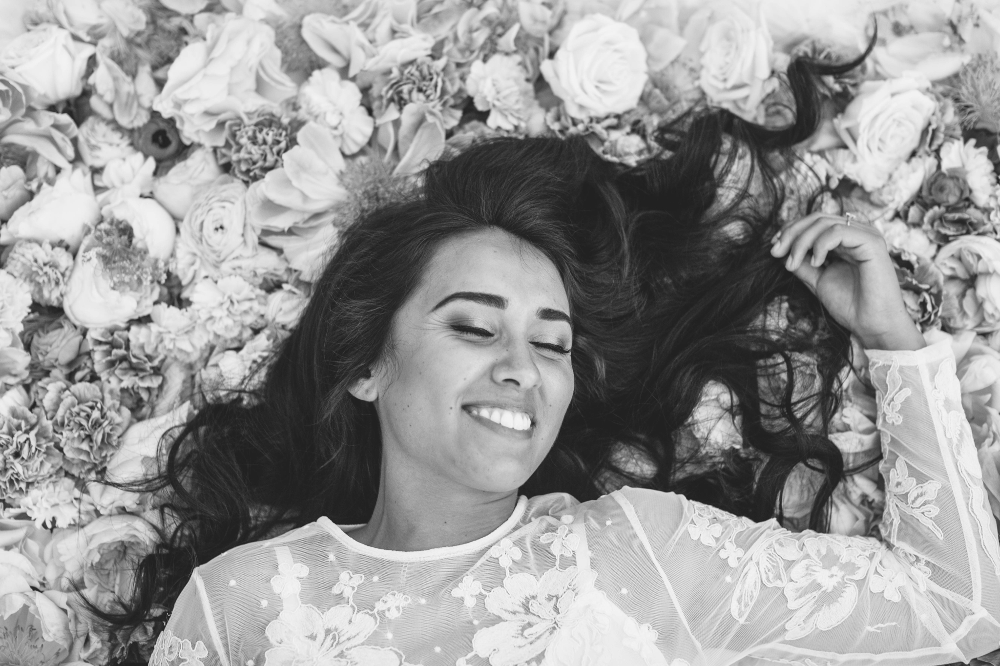 Bridal Portraits - Bride laying on a bed of flowers - Ana + Elijah - Wedding at Loulu Palm in Haleiwa, HI - Oahu Hawaii Wedding Photographer - #hawaiiweddingphotographer #oahuweddings #hawaiiweddings