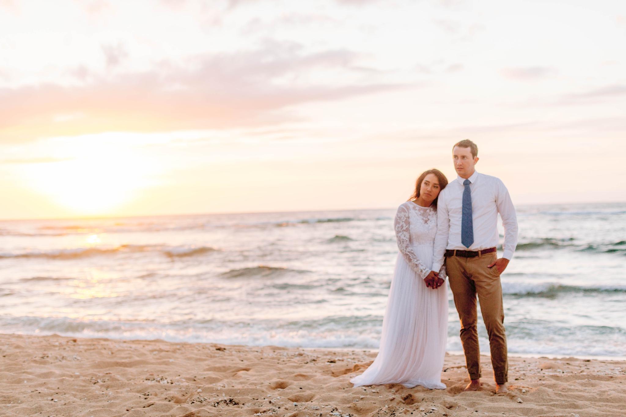 Beach Wedding Portraits at Sunset in Hawaii - Ana + Elijah - Wedding at Loulu Palm in Haleiwa, HI - Oahu Hawaii Wedding Photographer - #hawaiiweddingphotographer #oahuweddings #hawaiiweddings