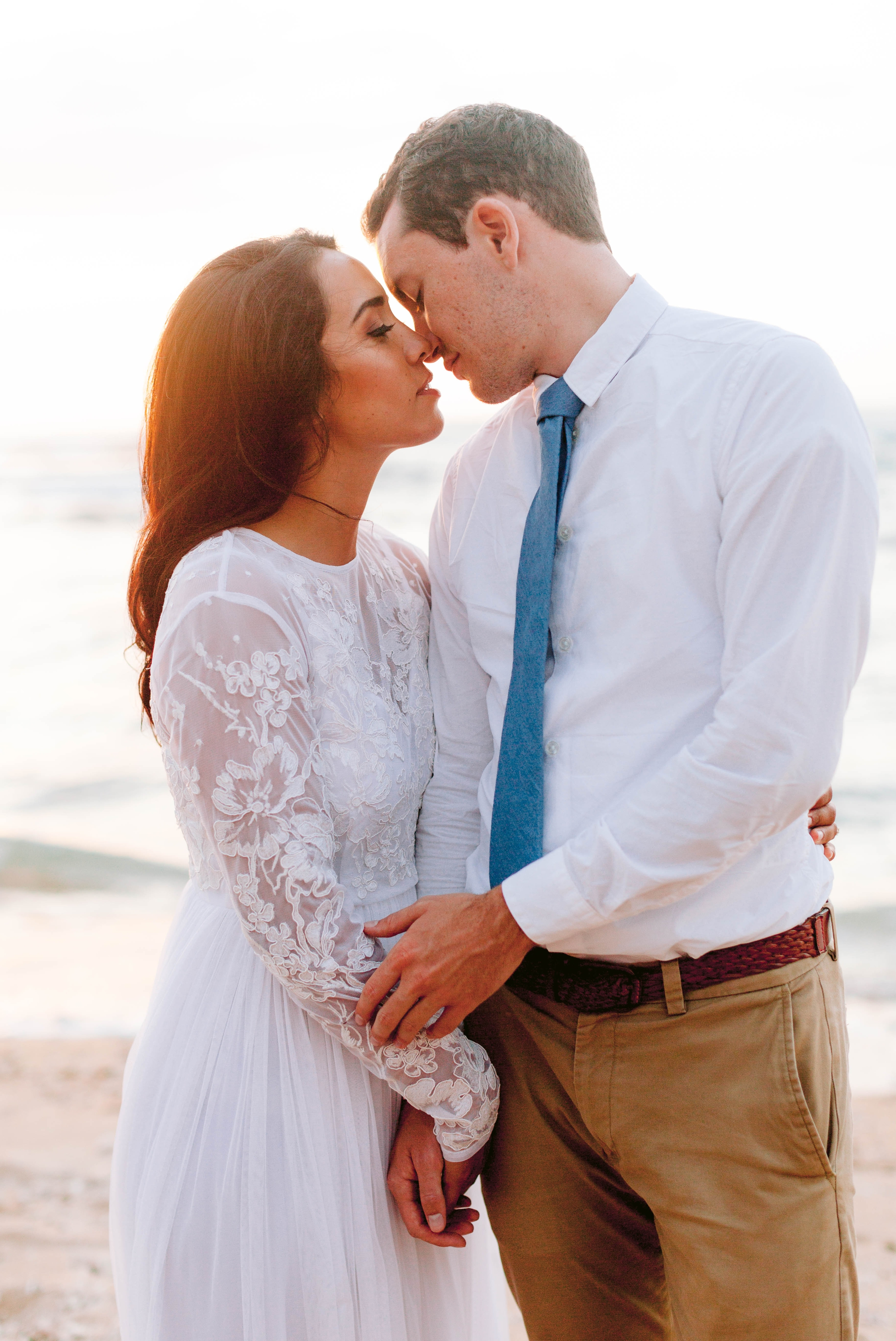 Bride and Groom Kissing - Beach Wedding Portraits at Sunset in Hawaii - Ana + Elijah - Wedding at Loulu Palm in Haleiwa, HI - Oahu Hawaii Wedding Photographer - #hawaiiweddingphotographer #oahuweddings #hawaiiweddings