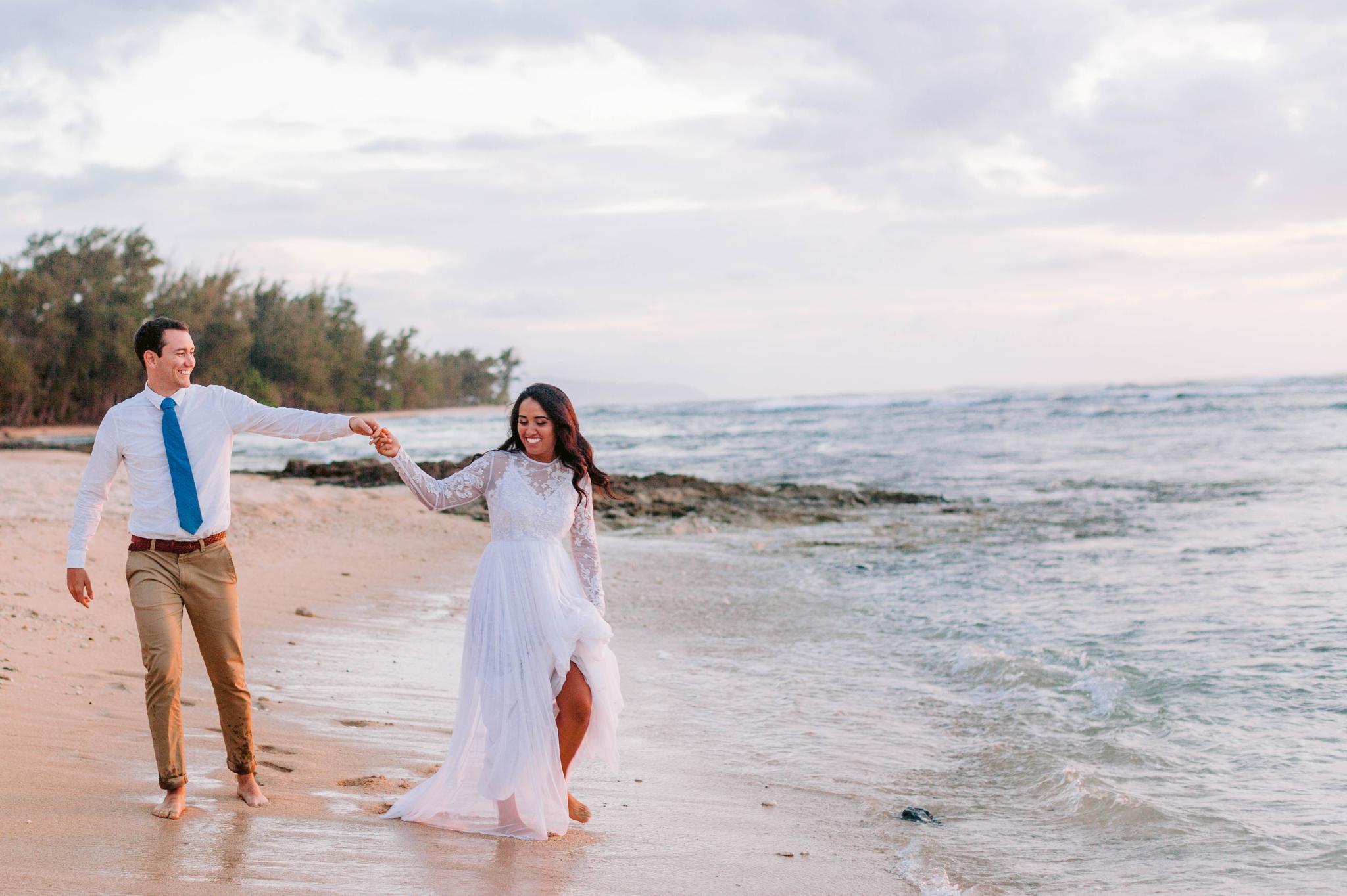 Bride and Groom walking on the beach - Wedding Portraits at Sunset in Hawaii - Ana + Elijah - Wedding at Loulu Palm in Haleiwa, HI - Oahu Hawaii Wedding Photographer - #hawaiiweddingphotographer #oahuweddings #hawaiiweddings