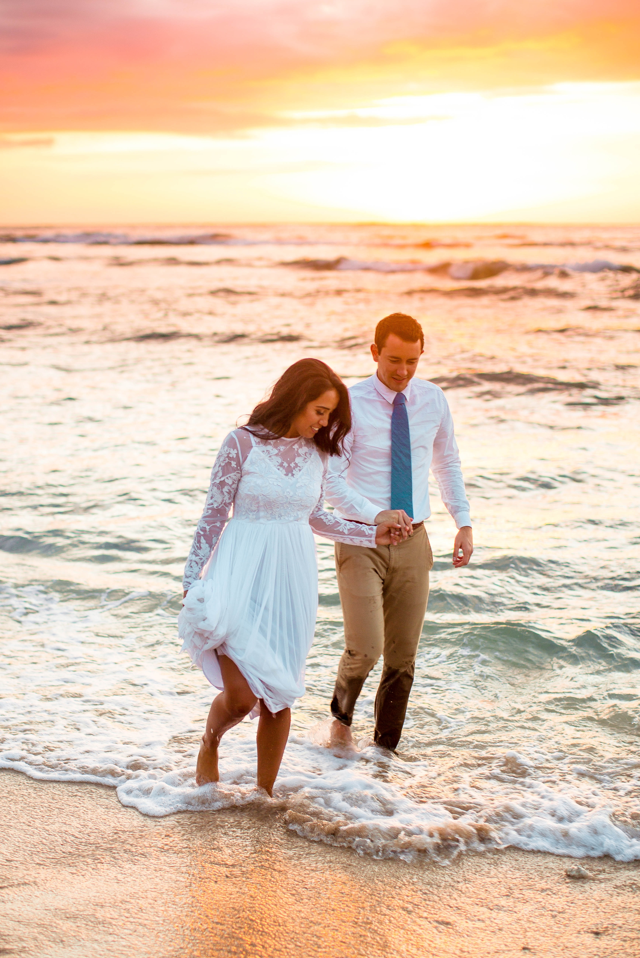 Bride and Groom in the ocean - Wedding Portraits at Sunset in Hawaii - Ana + Elijah - Wedding at Loulu Palm in Haleiwa, HI - Oahu Hawaii Wedding Photographer - #hawaiiweddingphotographer #oahuweddings #hawaiiweddings