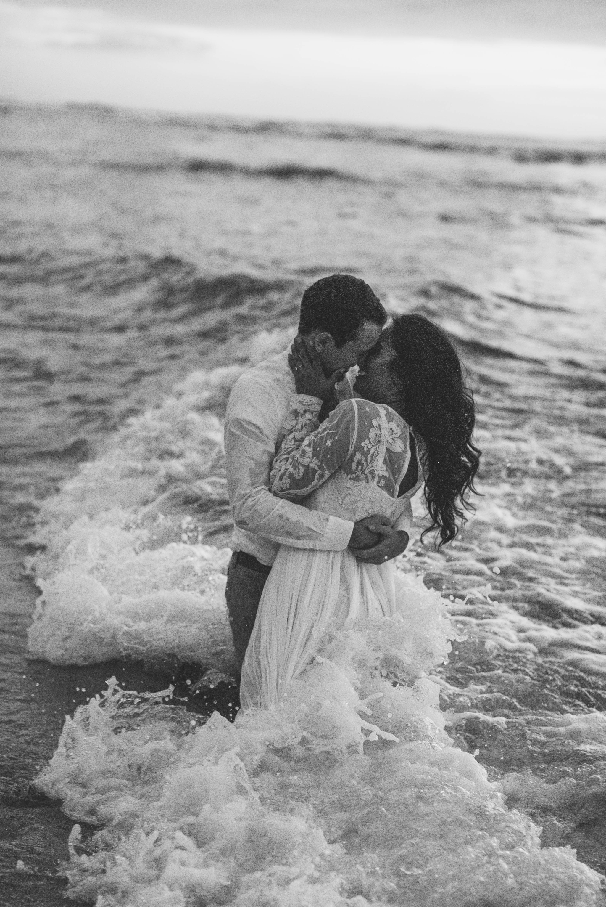 Bride and Groom in the ocean black and white - Wedding Portraits at Sunset in Hawaii - Ana + Elijah - Wedding at Loulu Palm in Haleiwa, HI - Oahu Hawaii Wedding Photographer - #hawaiiweddingphotographer #oahuweddings #hawaiiweddings