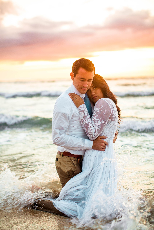 Bride and Groom in the ocean - Wedding Portraits at Sunset in Hawaii - Ana + Elijah - Wedding at Loulu Palm in Haleiwa, HI - Oahu Hawaii Wedding Photographer - #hawaiiweddingphotographer #oahuweddings #hawaiiweddings