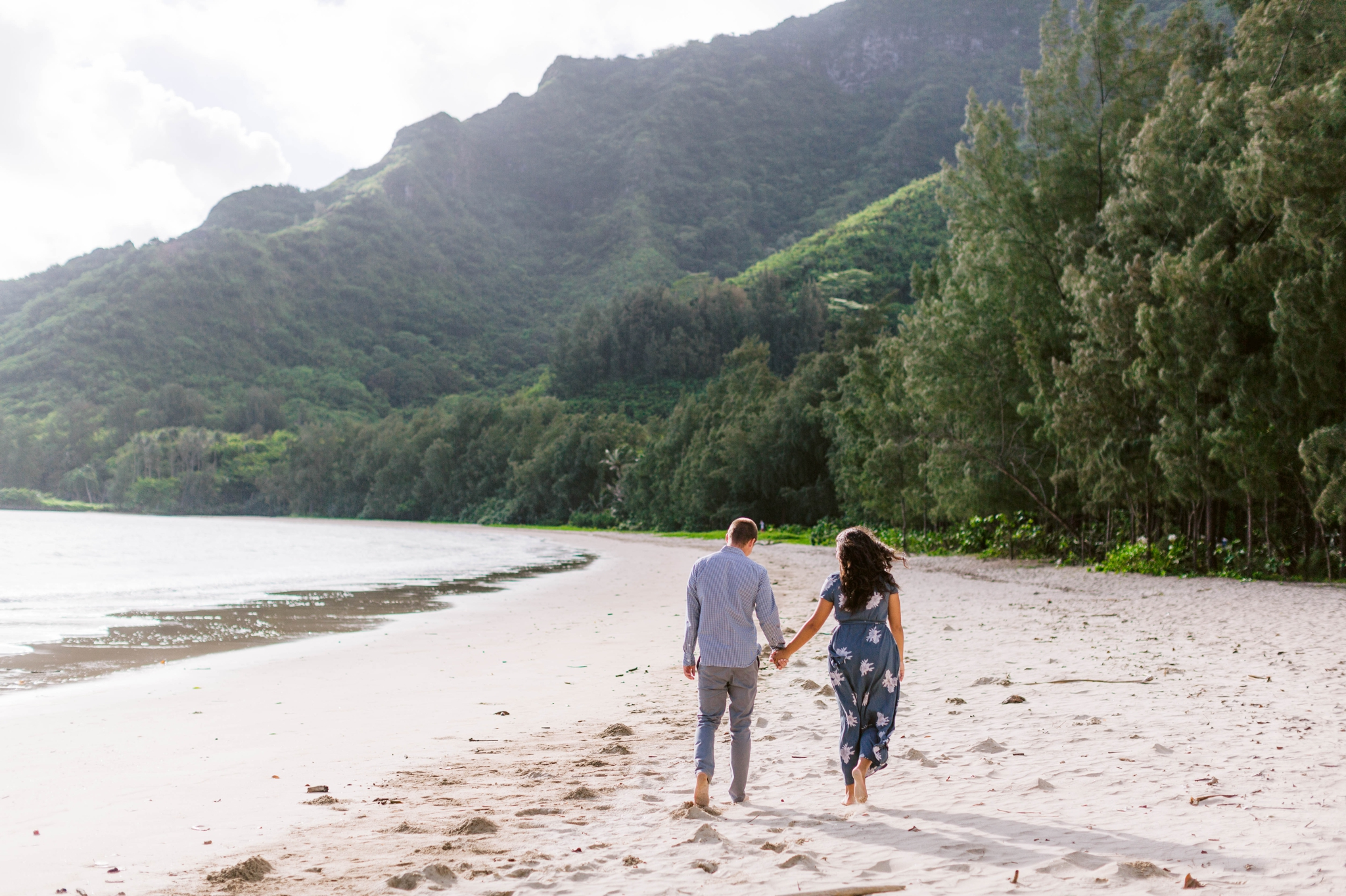 Couple Walking on the beach - Rilee + Max - Beach Engagement Session at Kahana Bay in Kaaawa, HI - Oahu Hawaii Wedding Photographer