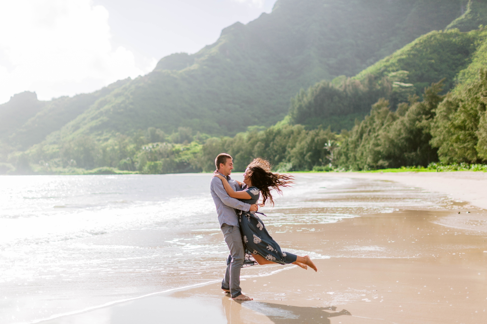Guy swinging his fiance around - Rilee + Max - Beach Engagement Session at Kahana Bay in Kaaawa, HI - Oahu Hawaii Wedding Photographer - #hawaiiengagementphotographer #oahuengagementphotographer