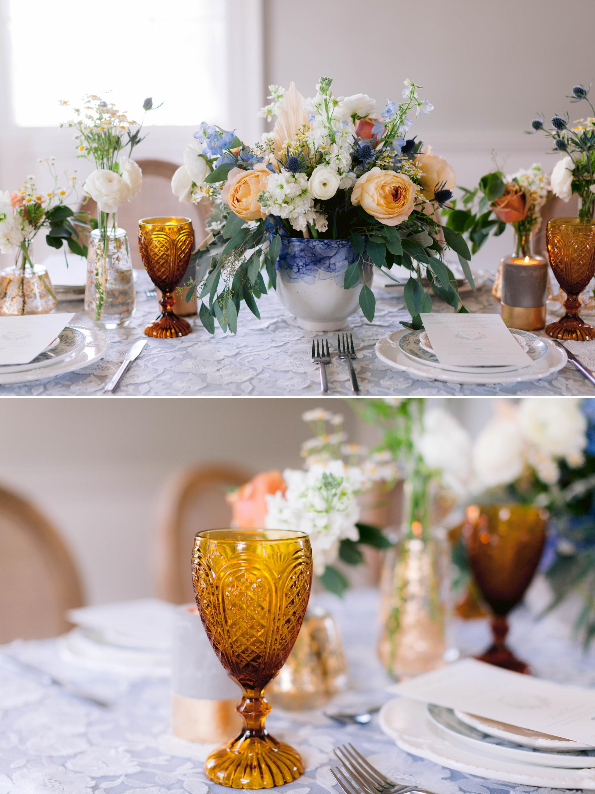 Table Set up with white and blue tablecloth, white and pastel china and pastel flowers - yellow orange wine glass - martha stewart weddings - style me pretty - Dusty Blue Wedding Inspiration - fine art photography - Honolulu, Oahu, Hawaii Wedding Photographer - johanna dye