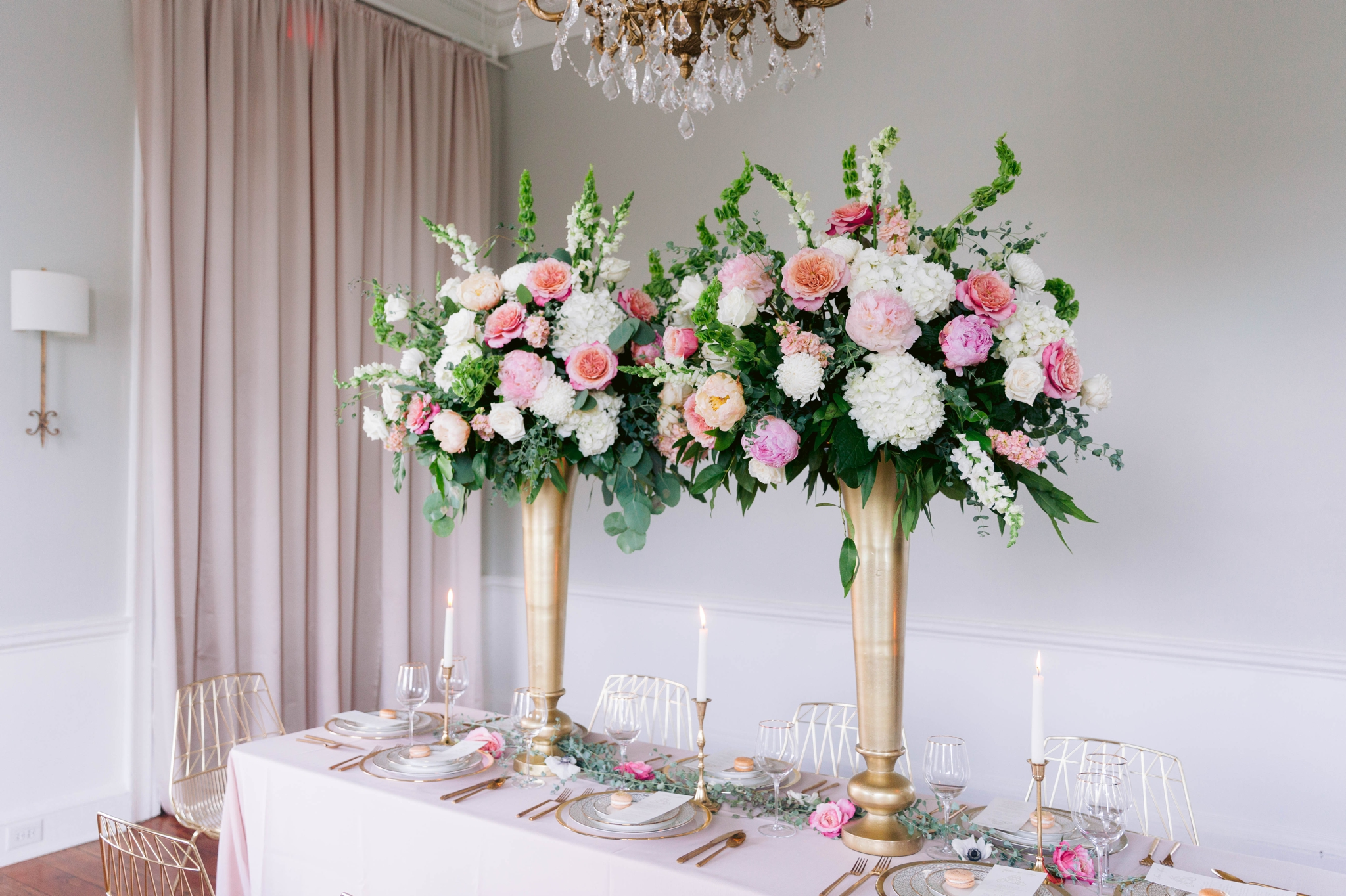 Table Set up with tall vases and draped flowers in blush and white - gold details in an estate -  Blush and Gold Wedding Inspiration - Honolulu, Oahu, Hawaii Wedding Photographer - Johanna Dye Photography - Martha Stewart Weddings - Style Me Pretty