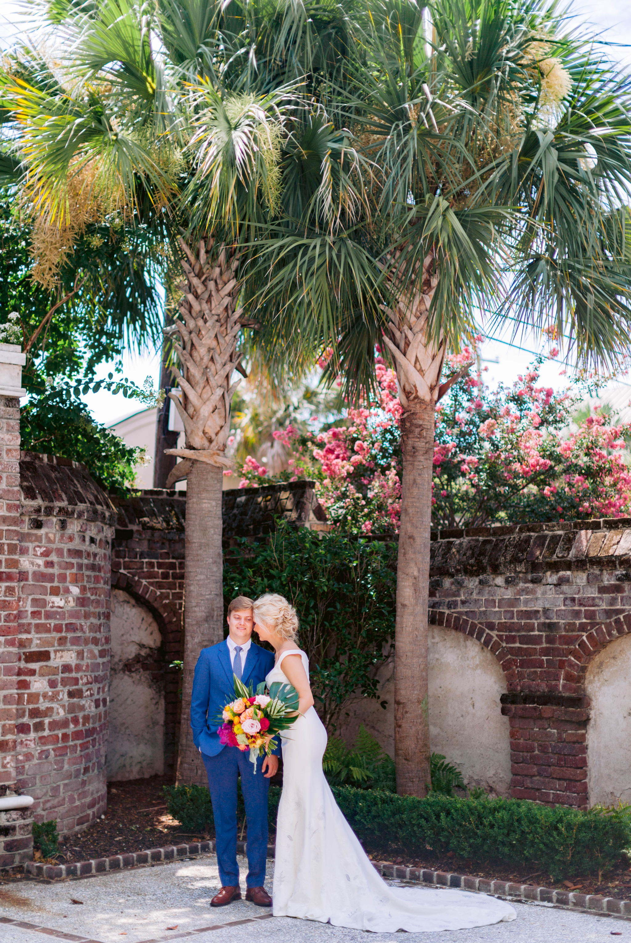 Bride and Groom Portraits with Industrial Brick and Palm Trees - Navy, Green, Gold and Berry colored Tropical Wedding Inspiration for your Wedding in Hawaii! - Honolulu, Oahu, Hawaii Photographer - Fine Art Film Photography - Light and Airy