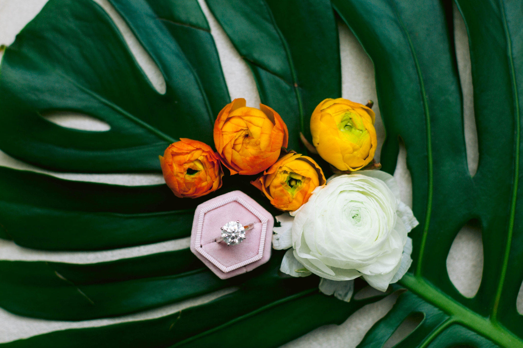 Huge Diamond Ring with a tropical leave and orange peonies  for your Hawaii Wedding - Navy, Green, Gold and Berry colored Tropical Wedding Inspiration for your Wedding in Hawaii! - Honolulu, Oahu, Hawaii Photographer - Fine Art Film