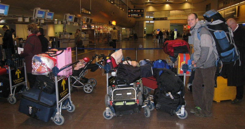 Early morning in the Stockholm airport. Moving back from Sweden to U.S.with two kids, two strollers, and more baggage than we can move.