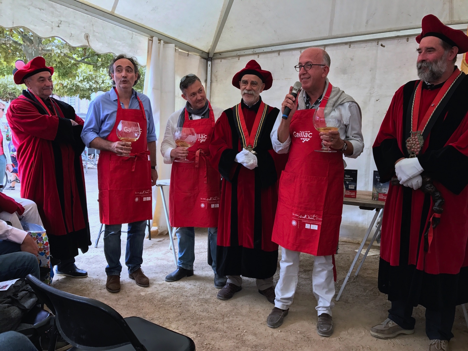 The tough life of a writer of wine mysteries: Induction ceremony to become members of the Gaillac Wine Brotherhood of the Dive Bouteille.